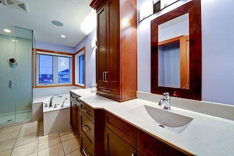Master ensuite large jacuzzi tub custom cabinetry